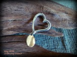 https://www.etsy.com/listing/250074882/reduced-20-silvertone-heart-cut-out-key?ref=shop_home_active_6