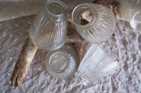four clear glass lamp covers