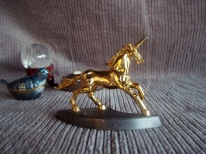 https://www.etsy.com/listing/484080549/carver-e-tripp-unicorn-3908-gold-gilded?ref=shop_home_active_9
