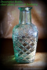 embossed bottle, clear glass, grapes & diamonds