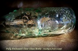 embossed bottle, clear glass, fruit motif