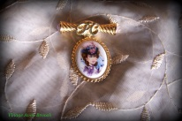 Avon Gibson girl cameo and scroll brooch