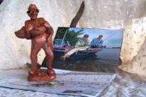 Red Mill, pecan figurine, fisherman