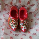 red wooden miniature clogs